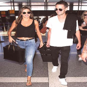 Miranda Kerr mastered casual summer style as she made her way through LAX airport with new boyfrien